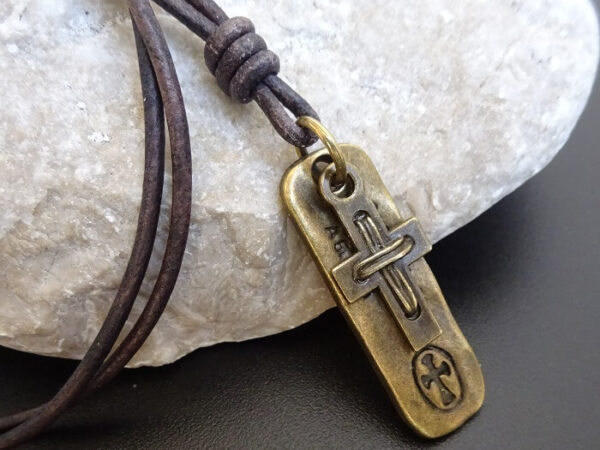 cross necklace on dog tag