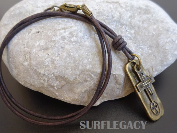 cross necklace on leather with dog tag