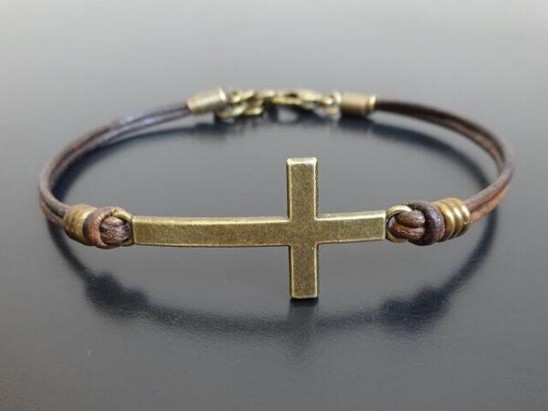 cross bracelet on leather
