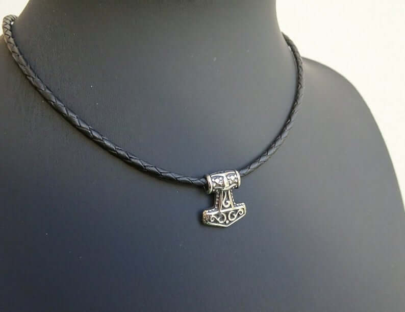 stainless steel mjolnir necklace on braided leather