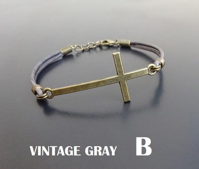 Bronze cross bracelet on leather adjustable